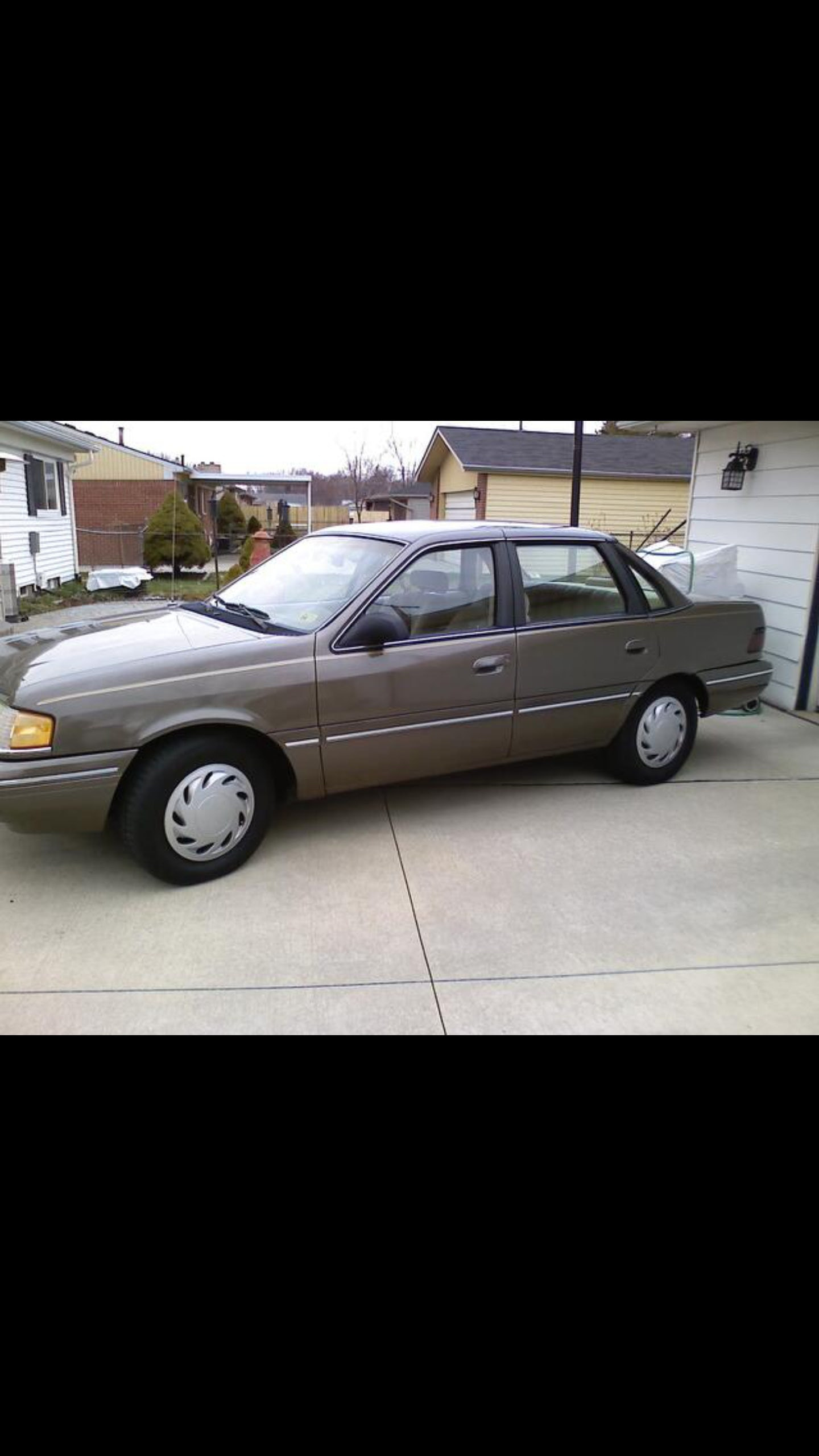 Junk 1990 Ford Tempo in Erial