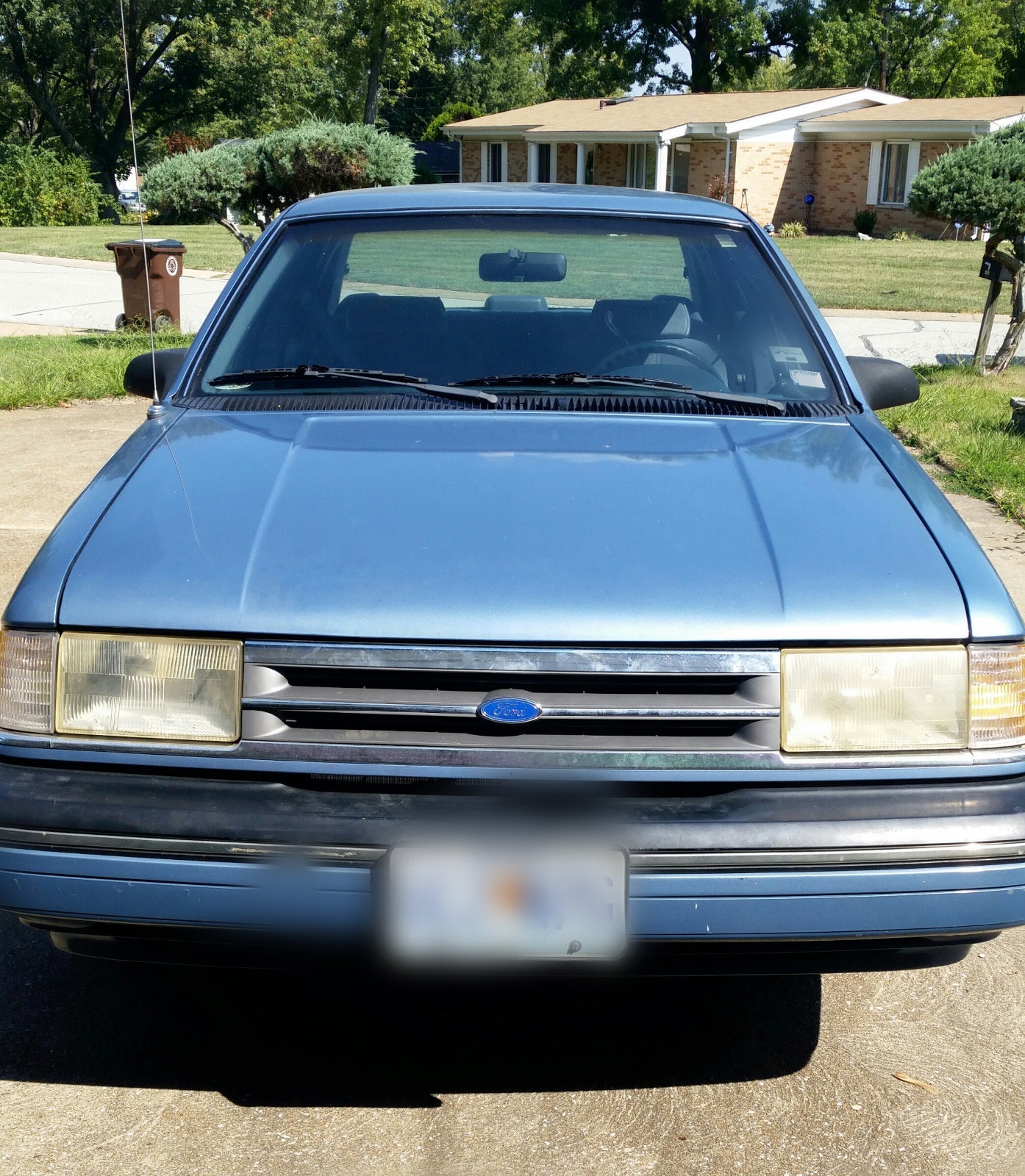 Junk 1990 Ford Tempo in Saint Louis
