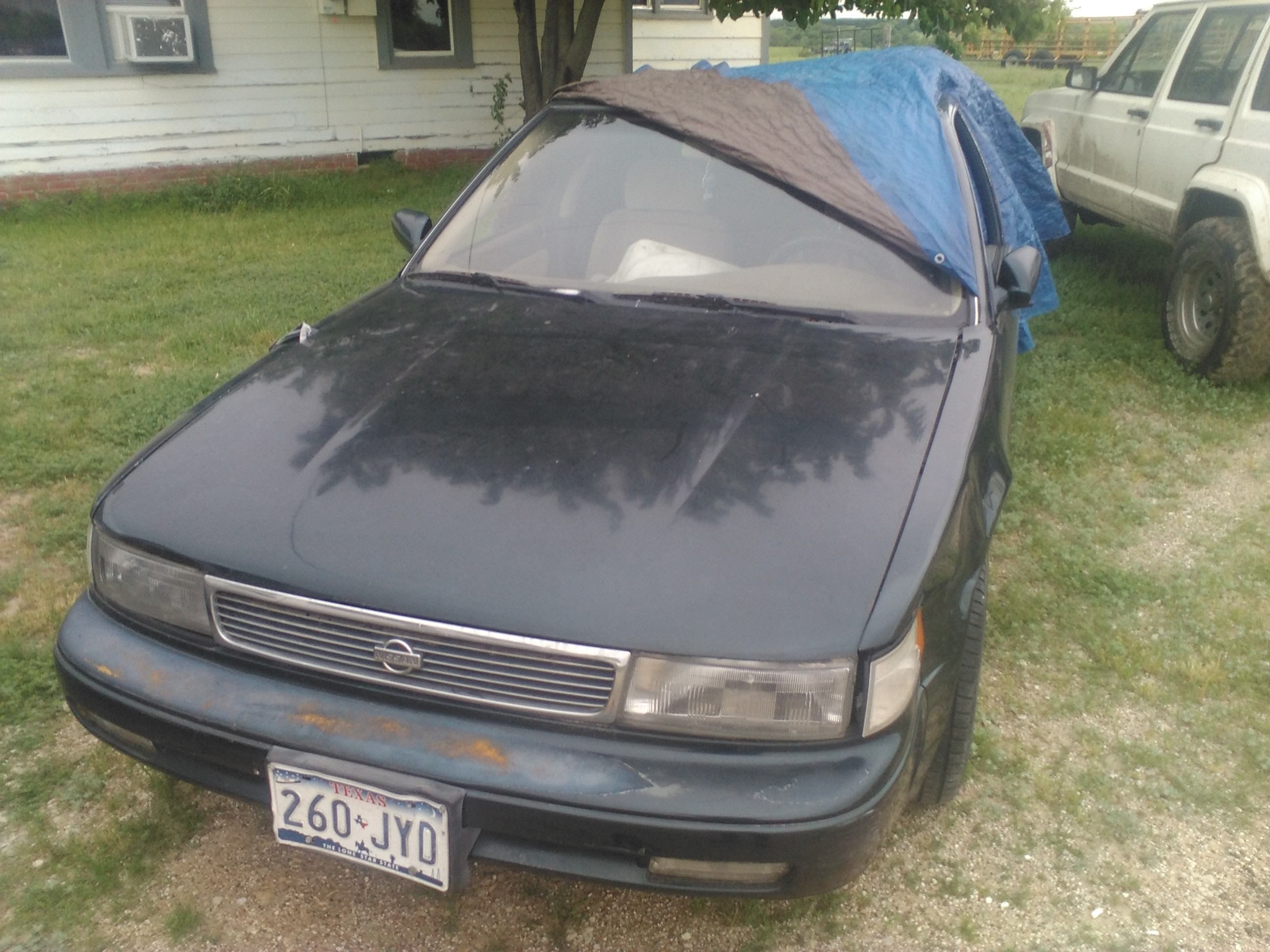 Junk 1994 Nissan Maxima in Oglesby