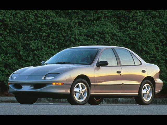 Junk 1998 Pontiac Sunfire in Forest