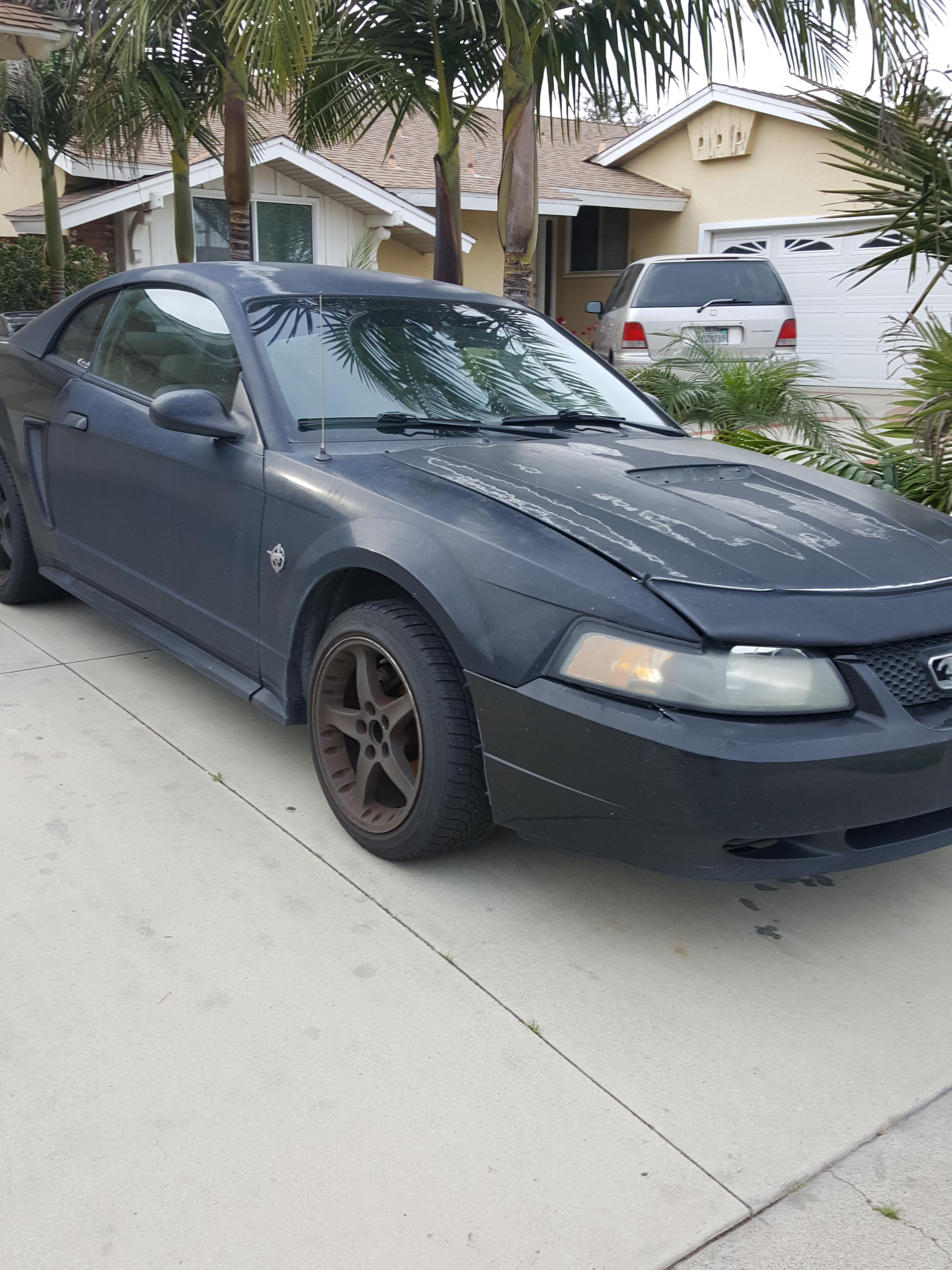 Junk 1999 Ford Mustang in Garden Grove