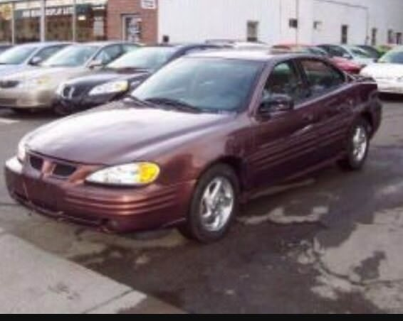 Junk 1999 Pontiac Grand Am in Alexandria