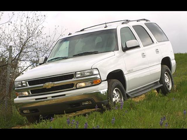 Junk 2001 Chevrolet Tahoe in Orange