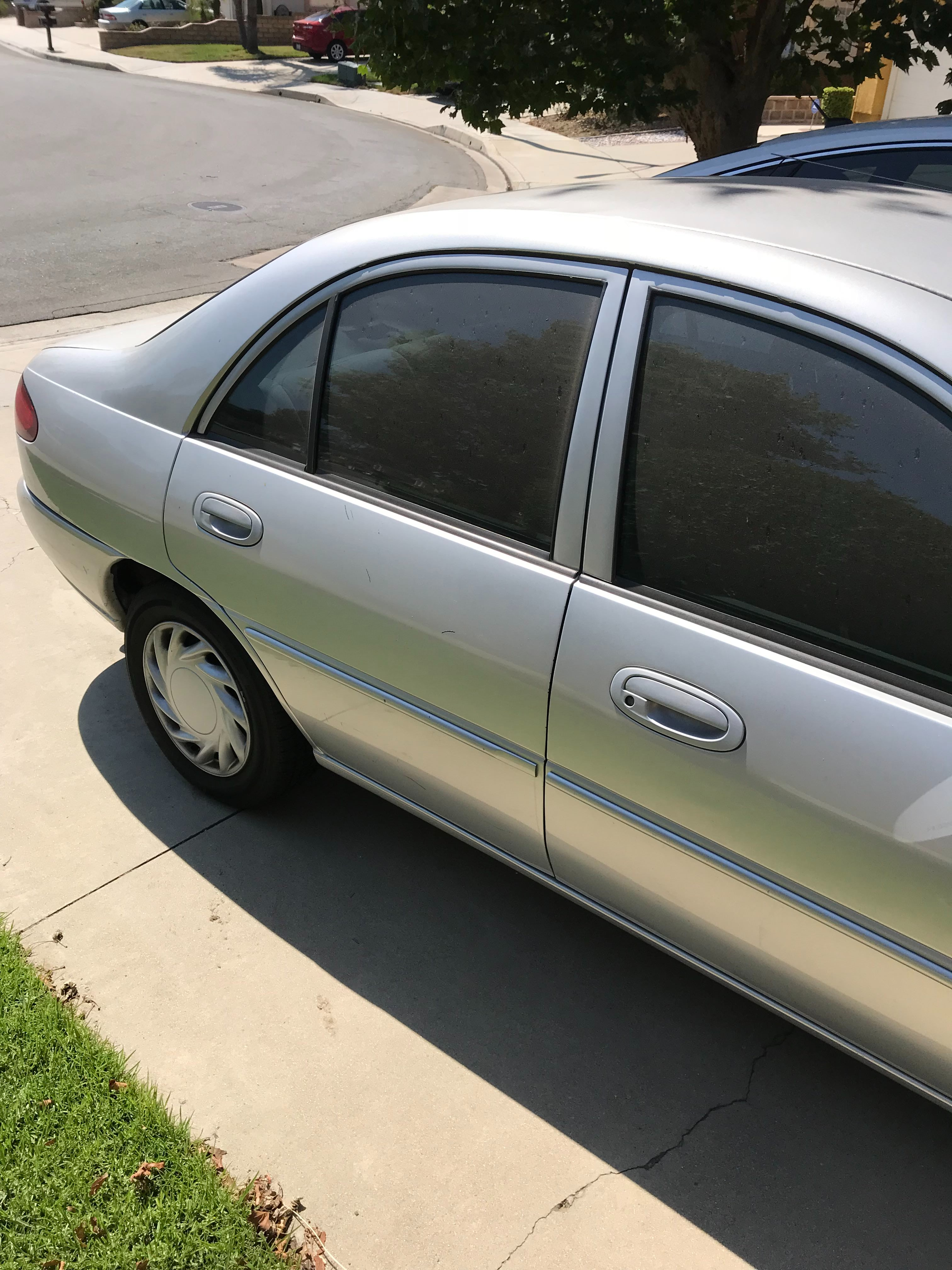 Junk 2002 Ford Escort in Chino Hills