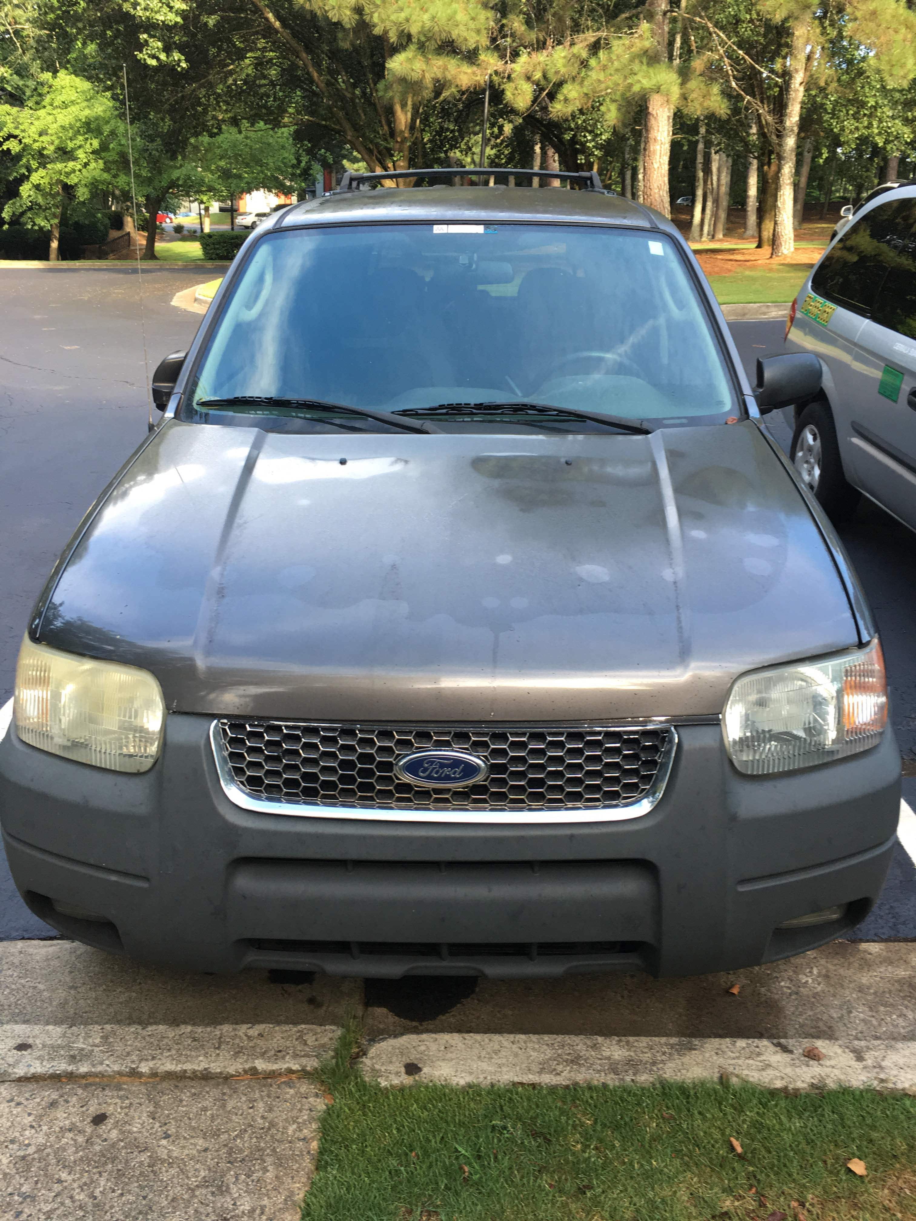 Junk 2003 Ford Escape in Marietta