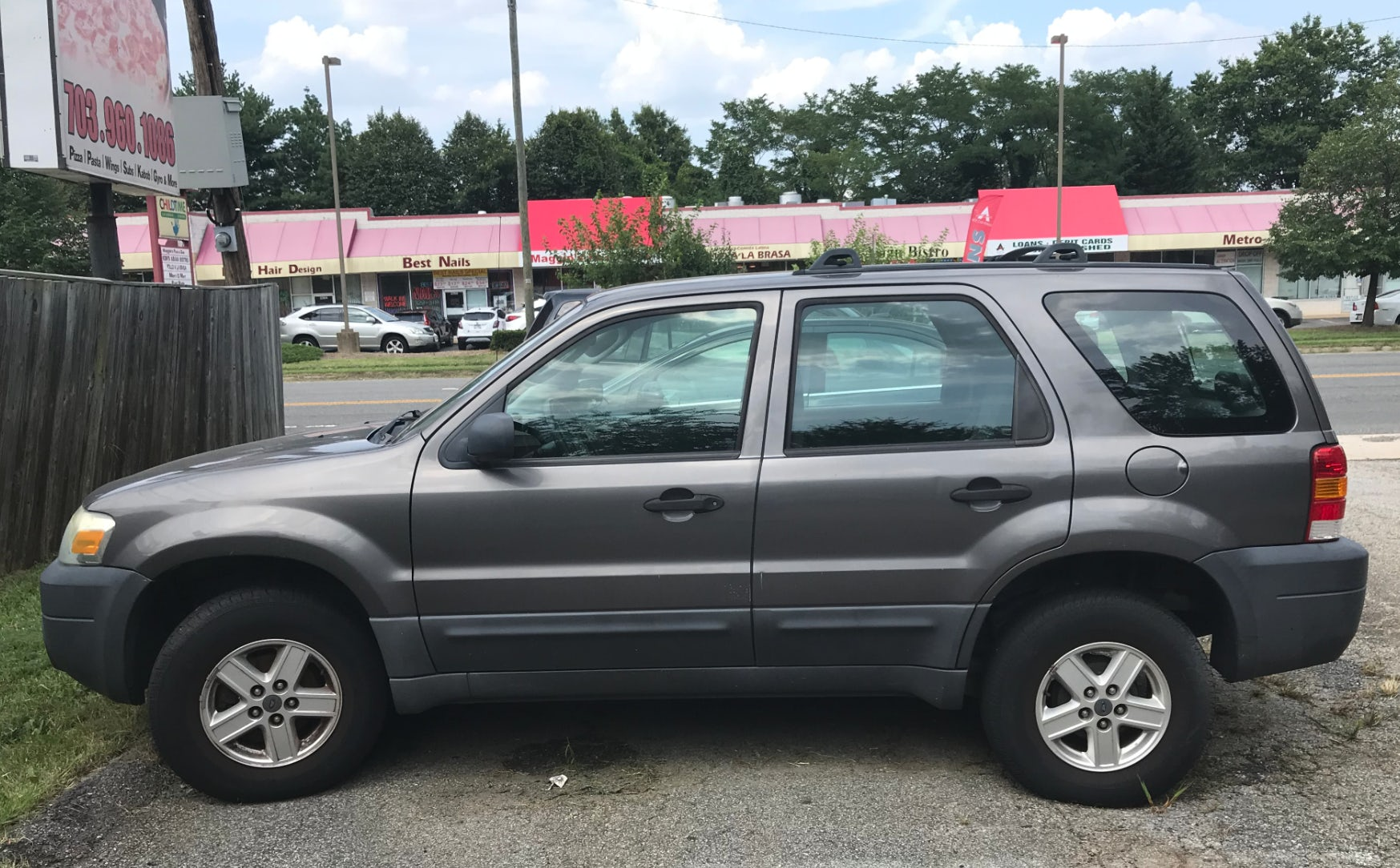 Junk 2006 Ford Escape in Alexandria