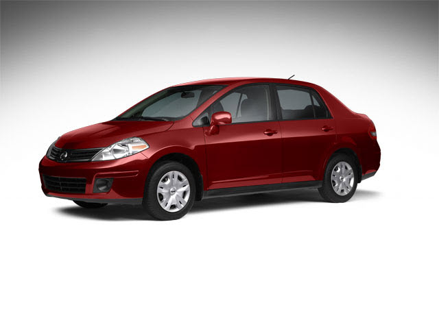 Junk 2011 Nissan Versa in West Hollywood