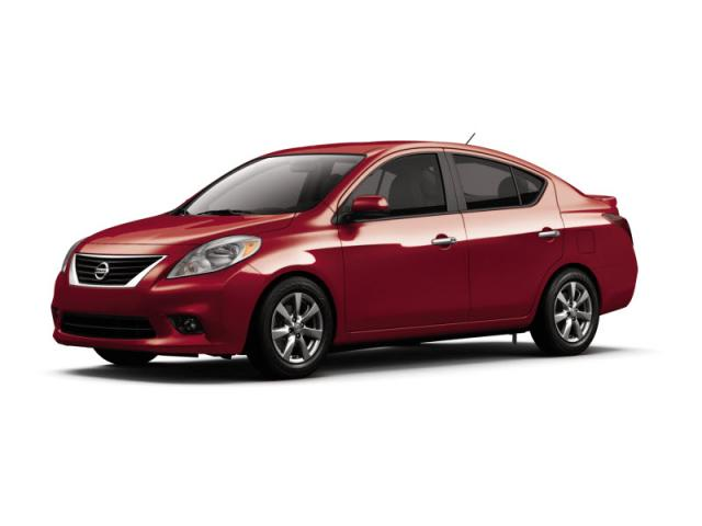 Junk 2013 Nissan Versa in Maple Heights