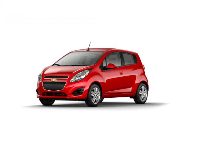 Junk 2014 Chevrolet Spark in Lutz